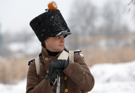 RUSSIA, APRELEVKA - FEBRUARY 7: Unidentified napoleonic war russian soldier with rifle in retro costume on reenactment of the Napoleonic maneuvers near the Aprelevka city, in 1812. Moscow region, Aprelevka, 7 February, 2015, Russia