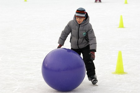 sport event: MOSCOW - JANUARY 25: Unidentified boy run with a ball on family sport event on January 25, 2015 in Moscow, Russia Editorial