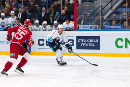 MOSCOW - JANUARY 10: M. Porseland (25) and J. Wright (38) in action on hockey game Vityaz vs Medvezchak on Russian KHL premier hockey league Championship on January 10, 2015, in Moscow, Russia. Medvezcak won 3:2 Editorial