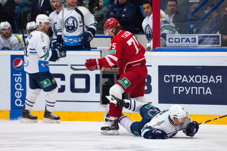 MOSCOW - JANUARY 10: M. Yakubov (75) and M. Pierre (93) in action on hockey game Vityaz vs Medvezchak on Russian KHL premier hockey league Championship on January 10, 2015, in Moscow, Russia. Medvezcak won 3:2