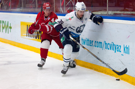 MOSCOW - JANUARY 10: A. Kudinov (44) and J. Wright (38) in action on hockey game Vityaz vs Medvezchak on Russian KHL premier hockey league Championship on January 10, 2015, in Moscow, Russia. Medvezcak won 3:2