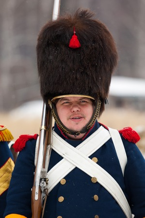 RUSSIA, APRELEVKA - FEBRUARY 7: Unidentified russian musketeer in uniform posing on reenactment of the Napoleonic maneuvers near the Aprelevka city, in 1812. Moscow region, Aprelevka, 7 February, 2015, Russia