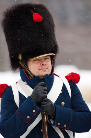 musketeer: RUSSIA, APRELEVKA - FEBRUARY 7: Unidentified russian musketeer in uniform posing on reenactment of the Napoleonic maneuvers near the Aprelevka city, in 1812. Moscow region, Aprelevka, 7 February, 2015, Russia