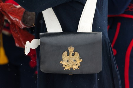 city coat of arms: RUSSIA, APRELEVKA - FEBRUARY 7: Coat of arms on musketeers bag on reenactment of the Napoleonic maneuvers near the Aprelevka city, in 1812. Moscow region, Aprelevka, 7 February, 2015, Russia