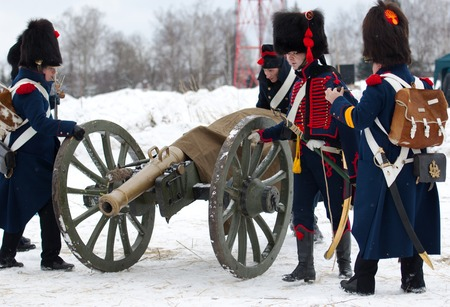 RUSSIA, APRELEVKA - FEBRUARY 7: Unidentified soldiers of cannon squad moving cannon on reenactment of the Napoleonic maneuvers near the Aprelevka city, in 1812. Moscow region, Aprelevka, 7 February, 2015, Russia