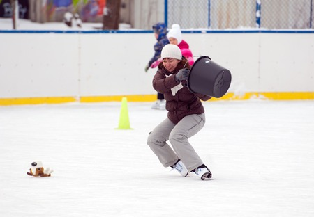 sport event: MOSCOW - JANUARY 25: Unidentified woman fall down with bucket on family sport event on January 25, 2015 in Moscow, Russia Editorial