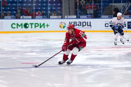 dribble: MOSCOW - JANUARY 10: D. Tsiganov (10) dribble on hockey game Vityaz vs Medvezchak on Russian KHL premier hockey league Championship on January 10, 2015, in Moscow, Russia.