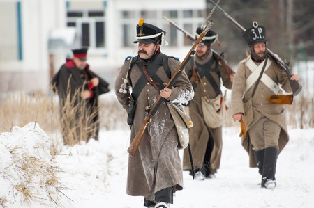 RUSSIA, APRELEVKA - FEBRUARY 7: Unidentified russian soldiers walking on reenactment of the Napoleonic maneuvers near the Aprelevka city, in 1812. Moscow region, Aprelevka, 7 February, 2015, Russia