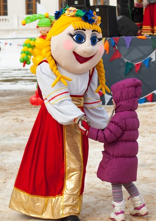 sudarium: PODOLSK, OSTAFIEVO, RUSSIA - FEBRUARY 21: Unidentified girl dance with a doll on Russian religious and folk holiday Maslenitsa in estate Ostafievo on February 21, 2015, near Podolsk, Russia