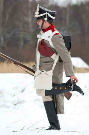 jackboot: RUSSIA, APRELEVKA - FEBRUARY 7: Unidentified Russian soldier clean a jackboot on reenactment of the Napoleonic maneuvers near the Aprelevka city, in 1812. Moscow region, Aprelevka, 7 February, 2015, Russia Editorial
