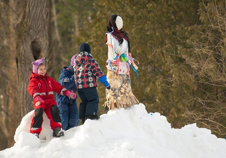 sudarium: PODOLSK, OSTAFIEVO, RUSSIA - FEBRUARY 21: Unidentified kids playing on hill of Maslenitsa doll on Russian religious and folk holiday Maslenitsa in estate Ostafievo on February 21, 2015, near Podolsk, Russia Editorial