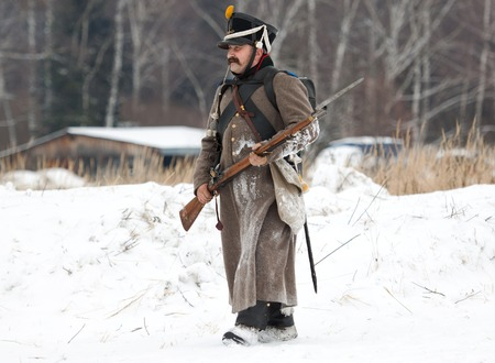 RUSSIA, APRELEVKA - FEBRUARY 7: Unidentified russian soldier walking on reenactment of the Napoleonic maneuvers near the Aprelevka city, in 1812. Moscow region, Aprelevka, 7 February, 2015, Russia