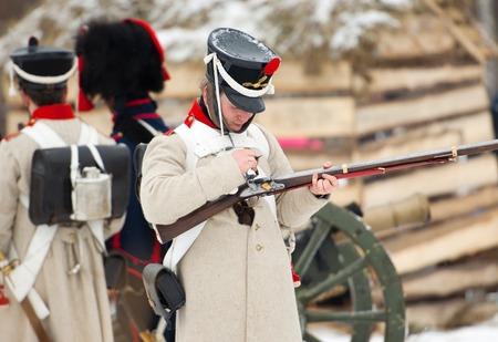 RUSSIA, APRELEVKA - FEBRUARY 7: Unidentified soldier reload the musket on reenactment of the Napoleonic maneuvers near the Aprelevka city, in 1812. Moscow region, Aprelevka, 7 February, 2015, Russia