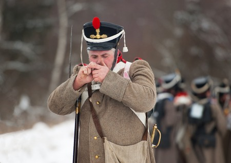 horse pipes: RUSSIA, APRELEVKA - FEBRUARY 7: Unidentified russian soldier fire the smoking pipe on reenactment of the Napoleonic maneuvers near the Aprelevka city, in 1812. Moscow region, Aprelevka, 7 February, 2015, Russia