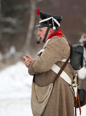 horse pipes: RUSSIA, APRELEVKA - FEBRUARY 7: Unidentified russian soldier smoking pipe on reenactment of the Napoleonic maneuvers near the Aprelevka city, in 1812. Moscow region, Aprelevka, 7 February, 2015, Russia