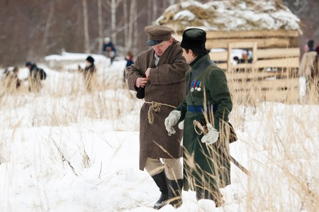 civilian: RUSSIA, APRELEVKA - FEBRUARY 7: Unidentified civilian and soldier walking on reenactment of the Napoleonic maneuvers near the Aprelevka city, in 1812. Moscow region, Aprelevka, 7 February, 2015, Russia Editorial