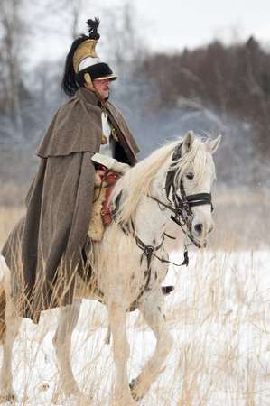 cavalry: RUSSIA, APRELEVKA - FEBRUARY 7: Unidentified russian cavalry soldier ride on a horse on reenactment of the Napoleonic maneuvers near the Aprelevka city, in 1812. Moscow region, Aprelevka, 7 February, 2015, Russia