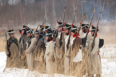 RUSSIA, APRELEVKA - FEBRUARY 7: Unidentified soldiers in row on reenactment of the Napoleonic maneuvers near the Aprelevka city, in 1812. Moscow region, Aprelevka, 7 February, 2015, Russia