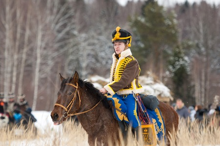 cavalry: RUSSIA, APRELEVKA - FEBRUARY 7: Unidentified cavalry soldier ride on horse on reenactment of the Napoleonic maneuvers near the Aprelevka city, in 1812. Moscow region, Aprelevka, 7 February, 2015, Russia Editorial