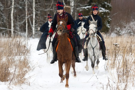RUSSIA, APRELEVKA - FEBRUARY 7: Unidentified cavalry soldier ride on reenactment of the Napoleonic maneuvers near the Aprelevka city, in 1812. Moscow region, Aprelevka, 7 February, 2015, Russia Editorial