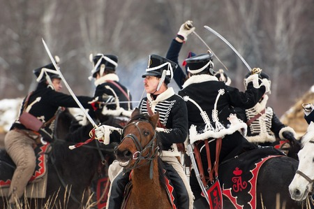 RUSSIA, APRELEVKA - FEBRUARY 7: Unidentified cavalry fight by swords on reenactment of the Napoleonic maneuvers near the Aprelevka city, in 1812. Moscow region, Aprelevka, 7 February, 2015, Russia