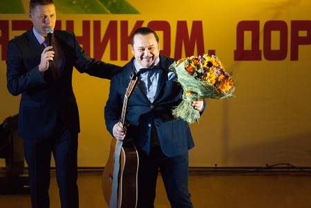 pop idol: MOSCOW, RUSSIA - MARCH 5: Igor Sarukhanov with a flowers on a scene during Womens Day performance in Moscow culture center Vostok on March 5, 2015 in Moscow, Russia Editorial