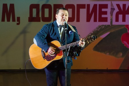 pop idol: MOSCOW, RUSSIA - MARCH 5: Igor Sarukhanov on a scene, singer, sing a song during Womens Day performance in Moscow culture center Vostok on March 5, 2015 in Moscow, Russia Editorial