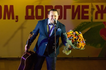 igor: MOSCOW, RUSSIA - MARCH 5: Igor Sarukhanov with a flowers on a scene during Womens Day performance in Moscow culture center Vostok on March 5, 2015 in Moscow, Russia Editorial