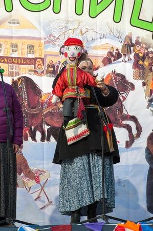 sudarium: PODOLSK, OSTAFIEVO, RUSSIA - FEBRUARY 21: Unidentified people with Petrushkla doll on a scene on Russian religious and folk holiday Maslenitsa in estate Ostafievo on February 21, 2015, near Podolsk, Russia