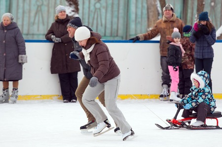 sport event: MOSCOW - JANUARY 25: Unidentified people run with sledge on family sport event on January 25, 2015 in Moscow, Russia