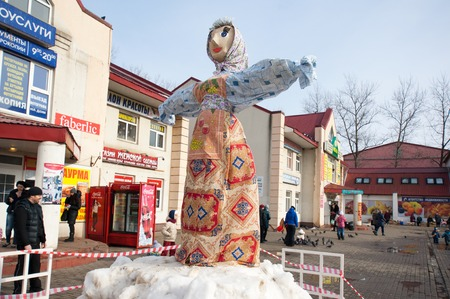 maslenitsa: MOSCOW, RUSSIA - FEBRUARY 22: Unidentified people near the Maslenitsa doll on Russian religious and folk holiday Maslenitsa near Culture center Peresvet on February 22, 2015, Russia Editorial