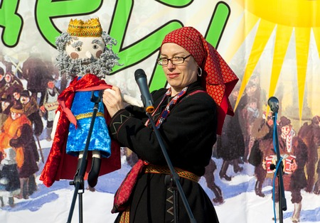 sudarium: PODOLSK, OSTAFIEVO, RUSSIA - FEBRUARY 21: Unidentified woman with king Pea doll on Russian religious and folk holiday Maslenitsa in estate Ostafievo on February 21, 2015, near Podolsk, Russia