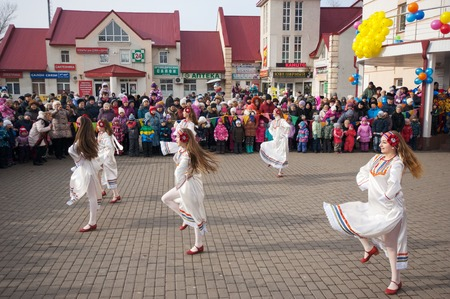 maslenitsa: MOSCOW, RUSSIA - FEBRUARY 22: Unidentified girls dance on square on Russian religious and folk holiday Maslenitsa near Culture center Peresvet on February 22, 2015, Russia