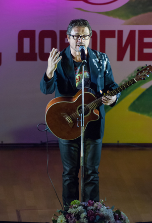 pop idol: MOSCOW, RUSSIA - MARCH 5: Singer Vladimir Markin sing a song on a scene during Womens Day performance in Moscow culture center Vostok on March 5, 2015 in Moscow, Russia Editorial