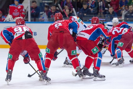6 12: MOSCOW - MARCH 12: A. Kuzmenko (96) and D. Denisov (6) on faceoff during hockey game Yokerit vs CSKA on Russia KHL championship on March 12, 2015, in Moscow, Russia. CSKA won 3:2