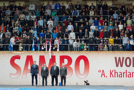 sambo: RUSSIA, MOSCOW - MARCH 27: Unidentified men stand on open ceremony of World Sambo Championship Kharlampiev memorial in Luzhniki sport palace, Moscow, Russia, 2015 Editorial