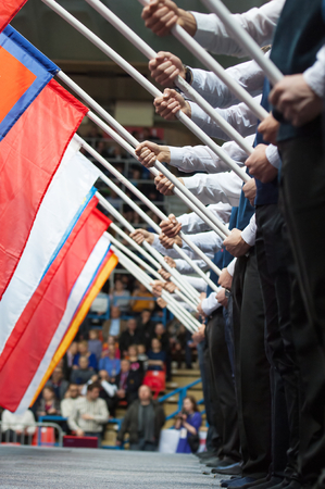 sambo: RUSSIA, MOSCOW - MARCH 27: Unidentified men holding a flags on World Sambo Championship Kharlampiev memorial in Luzhniki sport palace, Moscow, Russia, 2015 Editorial