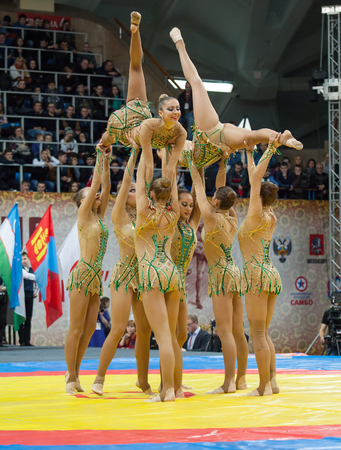 sambo: RUSSIA, MOSCOW - MARCH 27: Unidentified sportsmen of Russian national gymnastics aesthetic team dance on World Sambo Championship Kharlampiev memorial in Luzhniki sport palace, Moscow, Russia, 2015 Editorial