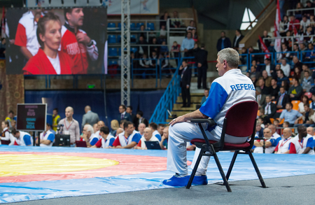 sambo: RUSSIA, MOSCOW - MARCH 27: Unidentified referee wait a start of fight on World Sambo Championship Kharlampiev memorial in Luzhniki sport palace, Moscow, Russia, 2015