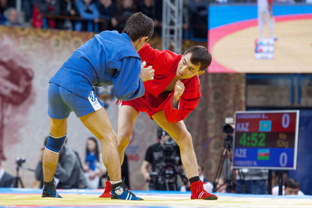 sambo: RUSSIA, MOSCOW - MARCH 27: Kanzhanov Beimbet (R) vs Umbayev Nasimid (B) on World Sambo Championship Kharlampiev memorial in Luzhniki sport palace, Moscow, Russia, 2015 Editorial