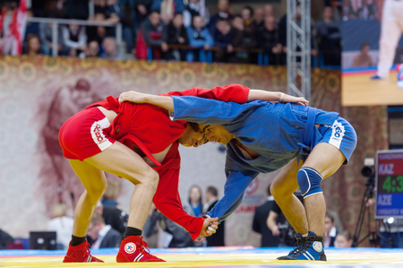 RUSSIA, MOSCOW - MARCH 27: Kanzhanov Beimbet (R) and Umbayev Nasimid (B) on World Sambo Championship Kharlampiev memorial in Luzhniki sport palace, Moscow, Russia, 2015 Editöryel