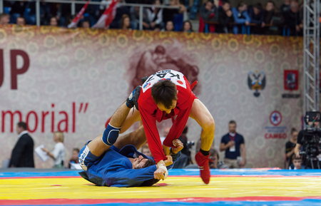 sambo: RUSSIA, MOSCOW - MARCH 27: Kanzhanov Beimbet (r) and Umbayev Nasimi (b) fight on World Sambo Championship Kharlampiev memorial in Luzhniki sport palace, Moscow, Russia, 2015