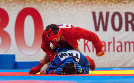 RUSSIA, MOSCOW - MARCH 27: Kanzhanov B. (Red) vs Umbayev N. (Blue) on World Sambo Championship Kharlampiev memorial in Luzhniki sport palace, Moscow, Russia, 2015