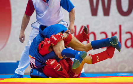RUSSIA, MOSCOW - MARCH 27: Kanzhanov B. (Red) and  Umbayev N. (Blue) fights on World Sambo Championship Kharlampiev memorial in Luzhniki sport palace, Moscow, Russia, 2015