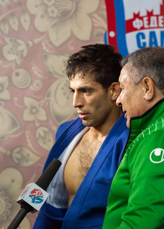 sambo: RUSSIA, MOSCOW - MARCH 27: Winner Umbayev Nasim gives an interview on World Sambo Championship Kharlampiev memorial in Luzhniki sport palace, Moscow, Russia, 2015
