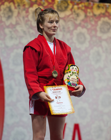 sambo: RUSSIA, MOSCOW - MARCH 27: Winner, Elena Bondareva,  stand on podium on World Sambo Championship Kharlampiev memorial in Luzhniki sport palace, Moscow, Russia, 2015