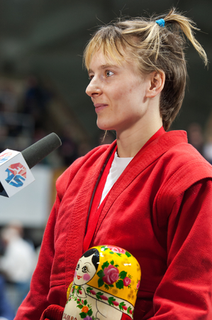 sambo: RUSSIA, MOSCOW - MARCH 27: Winner, Elena Bondareva,  gives an interview on World Sambo Championship Kharlampiev memorial in Luzhniki sport palace, Moscow, Russia, 2015 Editorial