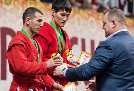 sambo: RUSSIA, MOSCOW - MARCH 27: Ernazov Sarbon and Serikov Nurbol on podium on World Sambo Championship Kharlampiev memorial in Luzhniki sport palace, Moscow, Russia, 2015