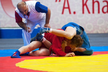 sambo: RUSSIA, MOSCOW - MARCH 27: Shorena Sharadze (R) and Katsiaryna Prakapenka (B) fights on World Sambo Championship Kharlampiev memorial in Luzhniki sport palace, Moscow, Russia, 2015 Editorial