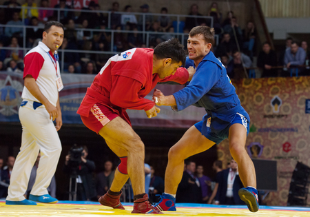 RUSSIA, MOSCOW - MARCH 27: Emil Khasanov (R) vs Evgeniy Sukhomlinov (B) on World Sambo Championship Kharlampiev memorial in Luzhniki sport palace, Moscow, Russia, 2015
